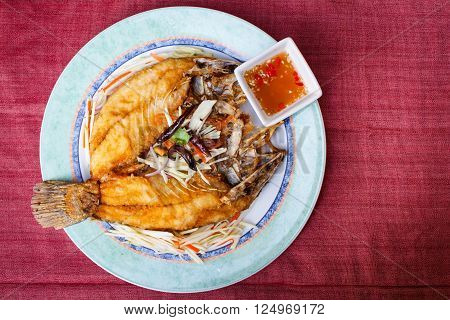Deep-fried snapper with spicy sauce style thai food.