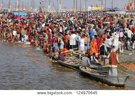 ALLAHABAD, INDIA - FEBRUARY 09, 2013: Thousands of Hindu devotees come to confluence of the Ganges and Yamuna River for holy dip during the festival Kumbh Mela. The world's largest religious gathering