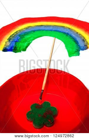 red bowl with red paint and a paint of a rainbow