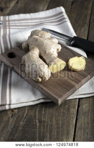 Fresh ginger root on a cutting board close up