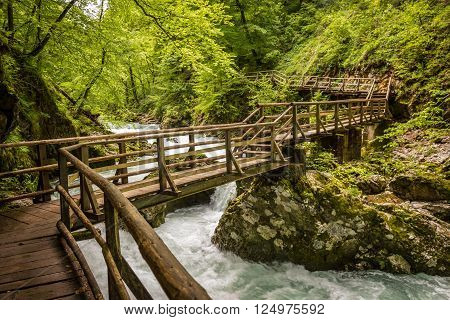 Wooden bridge across the mountain river in Vintgar Gorge in Slovenia