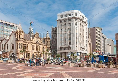 PORT ELIZABETH SOUTH AFRICA - FEBRUARY 27 2016: Unidentified tourists at the historic Market Square in Port Elizabeth. Several historic buildings are visible