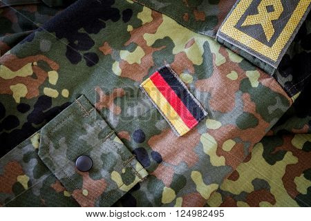 HANNOVER - GERMANY - APRIL 2016: german flag and chief petty officer badge on german military jacket in april 2016