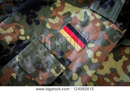 HANNOVER - GERMANY- APRIL 2016: German flag on german military jacket texture in april 2016