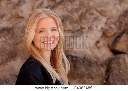 Portrait of blonde girl outdoor looking at camera