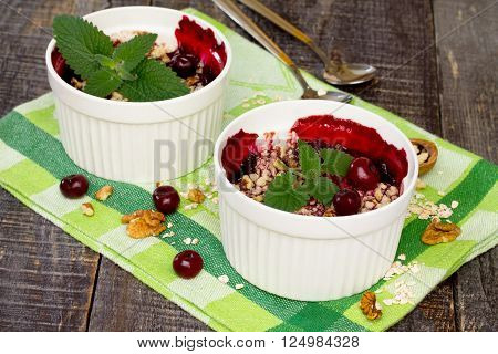 Homemade Cherry Crumble Dessert In A Rustic Style.