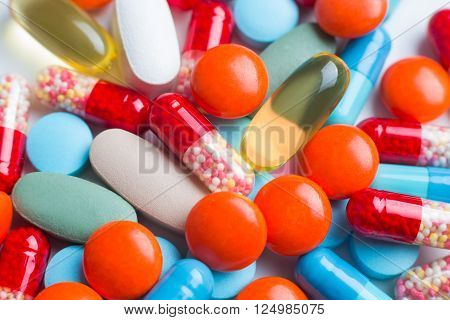 Many pills in pile different colours. Close up. Concept of medicines.