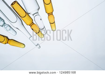Amber and transparent ampoules isolated on light background. Mock up