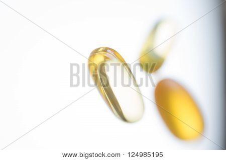 Golden pills close up. Concept of medicine.