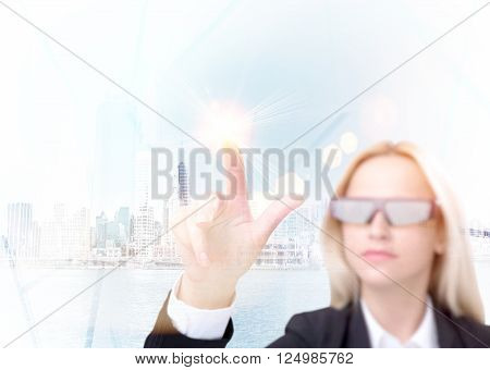 Businesswoman in 3D glasses touching virtual screen. New York at background. Concept of 3D glasses.