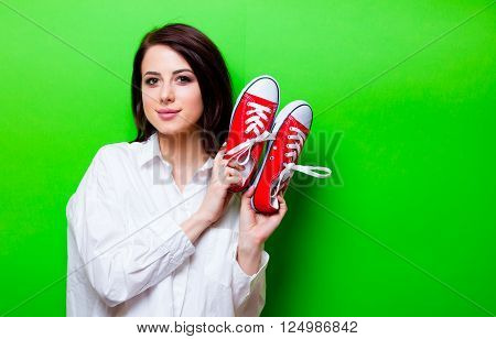 Portrait Of Young Woman With Gumshoes