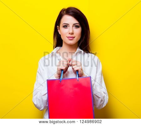 Portrait Of Young Woman With Shopping Bag
