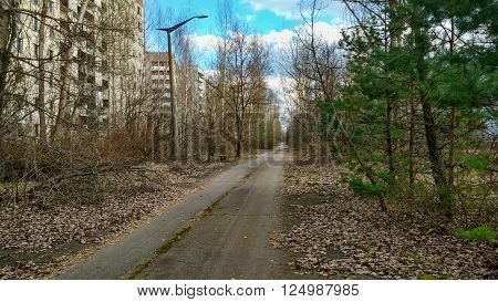 empty road in old ruined abandoned city Pripyat after nuclear disaster