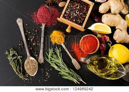 herbs condiments and spices on black background