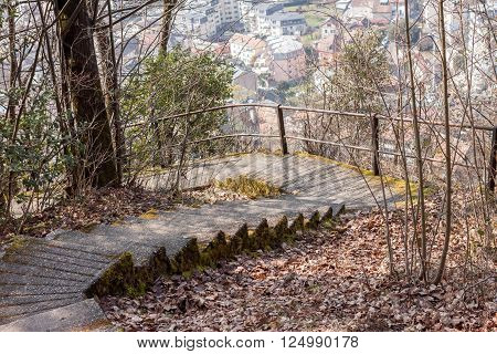 old green mossy staircase over the village in Switzerland