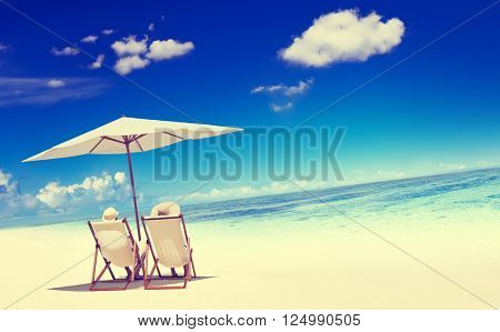 Couple Sitting Beach Summer Getaway Concept