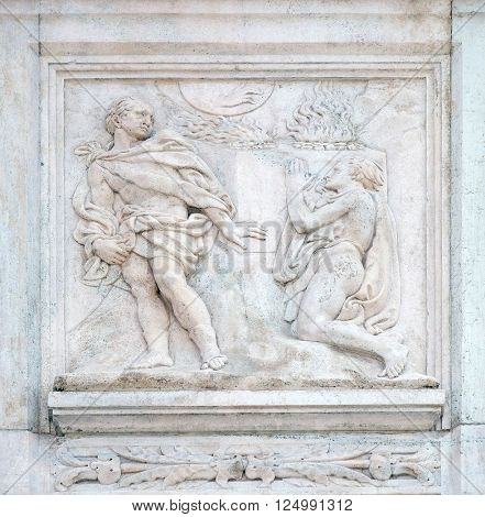 BOLOGNA, ITALY - JUNE 04: Cain and Abel sacrifices, Genesis relief on portal of Saint Petronius Basilica in Bologna, Italy, on June 04, 2015