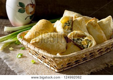 Pie With Small Egg And Green Onion On A Wooden Table