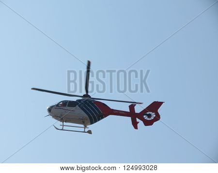 PRAGUE CZECH REPUBLIC - CIRCA MARCH 2012: Helicopter flying high in the blue sky