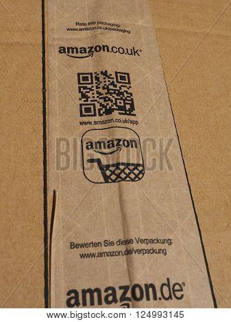 LONDON UK - CIRCA JANUARY 2016: Brown corrugated cardboard with Amazon logo on adhesive tape