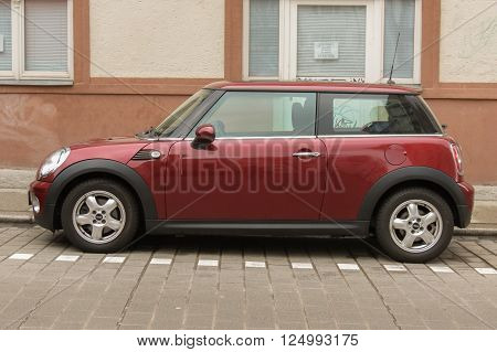 HALLE (SAALE) GERMANY - CIRCA MARCH 2016: dark red or maroon Mini Cooper car