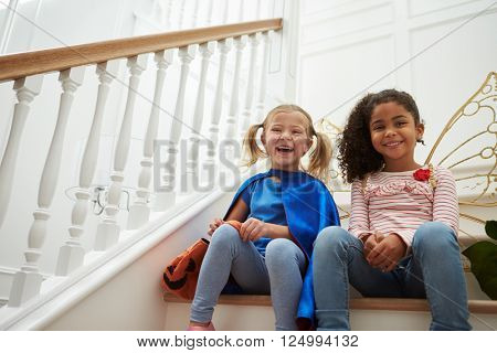 Two Girls Playing Dressing Up Games Sitting On Stairs