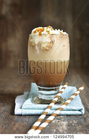 Frappuccino With Caramel Syrup And Whipped Cream.