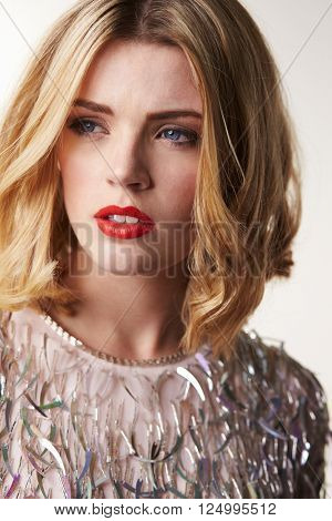Glamorous blonde woman looking away, vertical portrait