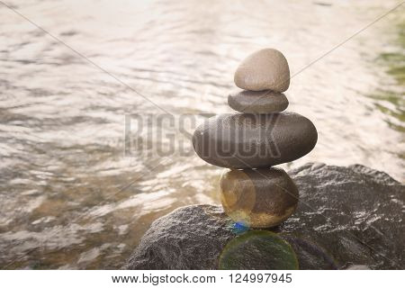Superimposed Waterfall Pebble Rock Arranged On Big Stone
