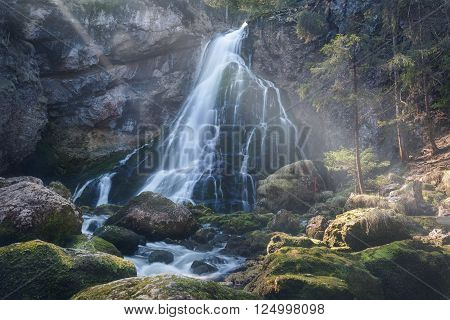 Waterfall in Golling a little town in Austria . Fairytale scene with sunbeams