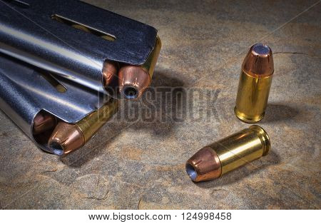 Cartridges with hollow point bullets and a pairof steeol magazines