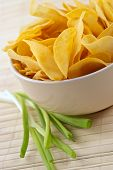 stock photo of potato chips  - snack from crackling potato chips with cheese and an onions - JPG
