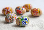 stock photo of ecclesiastical clothing  - Painted Colorful Easter Eggs on Beige Huckaback Towel - JPG