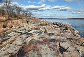 foto of gneiss  - View of very old and rocky coastline in a city park - JPG