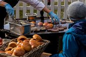 Outdoor Kitchen Hamburger Sizzling On A Frying Table poster