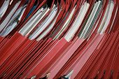 stock photo of business-office  - office shelf of red folders files leaning to one side - JPG