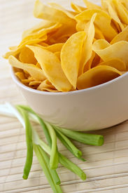 pic of potato chips  - snack from crackling potato chips with cheese and an onions - JPG