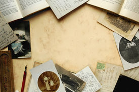pic of vintage antique book  - vintage border as a still life with old books postcards photographs pen and wooden pen - JPG