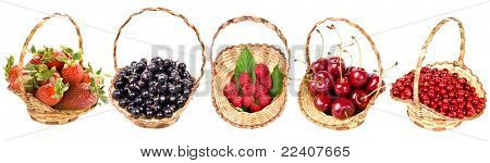collection of ripe useful  berries in the baskets, isolated on a white background