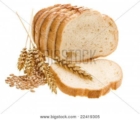 bread loaf and wheat  ears isolated over white
