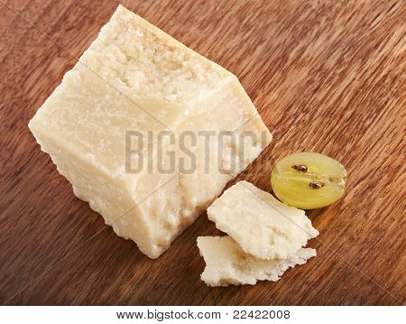 cheese parmesan on wooden board