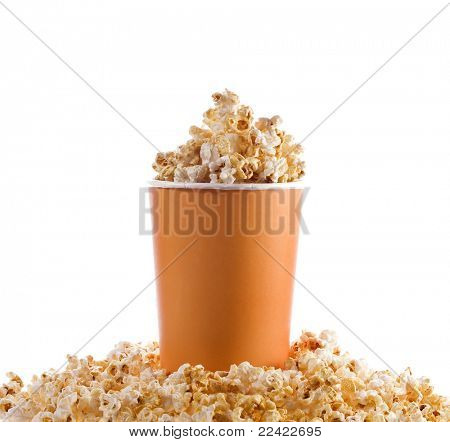 pop corn in caramel syrup in the paper box isolated on white