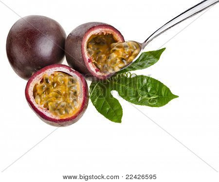 Passion fruit with spoon on a white background