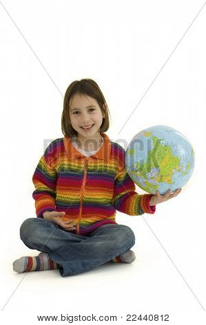 young girl holding the world globe isolated on white