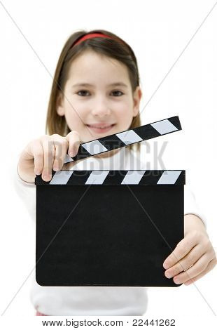 young girl holding a movie clapper isolated on white background