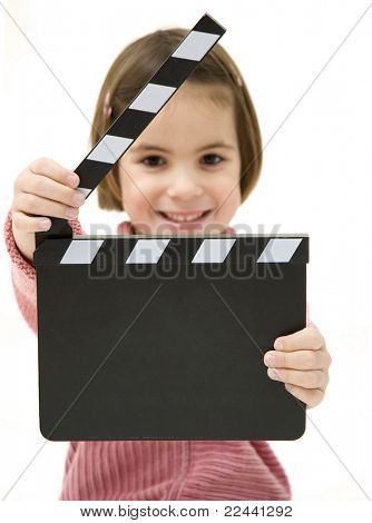 Little girl with a clapperboard isolated on white background