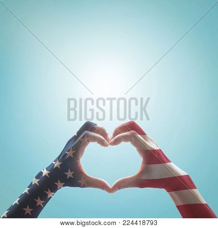 poster of American Flag Pattern On People Hands In Heart Shaped Form Against Vintage Sky Background W/ Clouds: