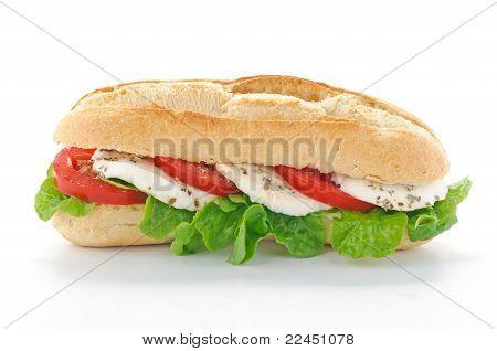 Sandwich with mozzarella, tomato and salad