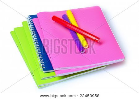bright notebooks and markers isolated on white