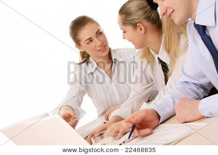 A businessgroup working at the table, isolated on white